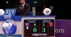The scores in a table tennis match is being displayed in a digital scoreboard